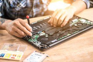 a man repairing a laptop